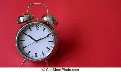 Metal vintage alarm clock counting - Closeup of metal...