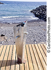 Metal water tap in the beach by the sea
