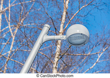 Metal white lantern in the winter city park.