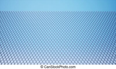 Metal wire mesh against a blue sky 4k