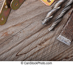 Metal work tools on the old wooden background