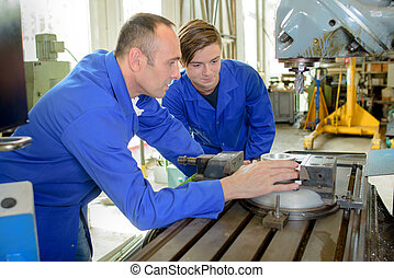 metal worker with apprentice