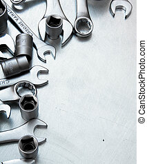 Wrenches on the scratched metal background.