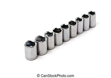 Metal wrench sockets close up isolated on a white background...