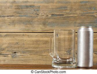 metallic can and glass blank mug of beer