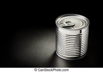 Metallic can on black grained surface