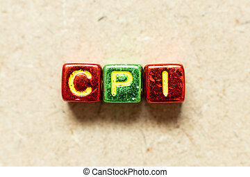 Metallic color alphabet letter block in word CPI (abbreviation of Consumer Price Index) on wood background