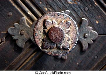 Metallic decoration motif on a door