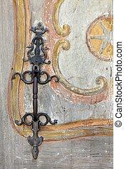 metallic door handle - metallic  handle on old wooden door