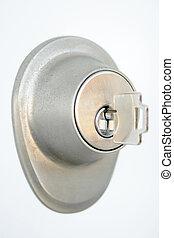 Metallic door lock with a key - Close-up of metallic door ...