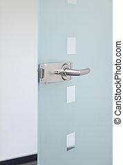 metallic door´s handle - modern glass door and metallic...