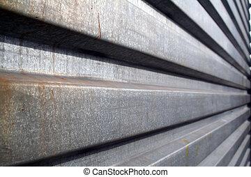 metallic grate - an angles shot of metallic galvanized steel...