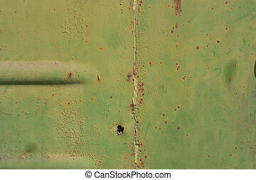 Metallic green background with rust.