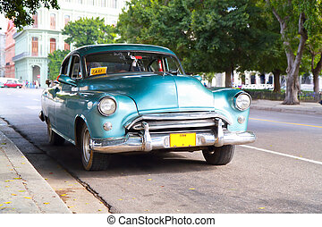 Metallic green oldtimer car in the streets of Havana -...