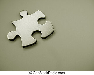 Metallic jigsaw puzzle piece