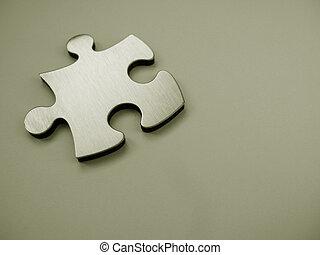 Metallic jigsaw puzzle piece