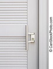 knob on white door