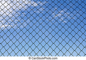 metallic net with blue sky background