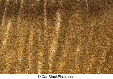Metallic surface - A golden matalic and wavy surface pattern