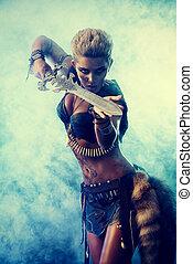 metallic sword - Portrait of a beautiful female warrior in...