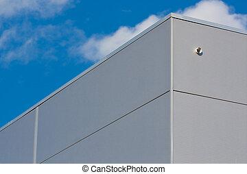 Metallic warehouse with blue sky