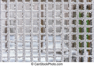 Metallic wire fence completely covered with frost - Squared...