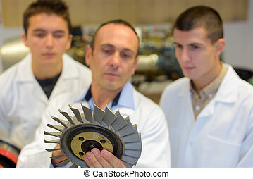 metallurgical engineers with a blade