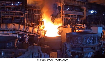 Loading additives into container with liquid metal in open hearth workshop of the metallurgical plant