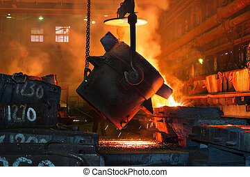 Metallurgical plant, hot metal casting. - Pouring of liquid...