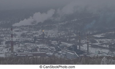 Metallurgical plant. Pipes with smoke, carbon dioxide emissions into the atmosphere. Industry landscape winter. Pollution of the environment by a industry