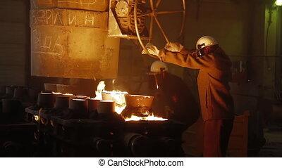 Metallurgist Job Workers In A Steel Plant Hot Molten Metal Pouring. Blast Furnace Steel Production Steel Works. Pouring Hot Liquid Metal From Furnace Metallurgical Plant. Worker Heavy Industry Factory