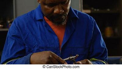 Metalsmith using caliper in workshop 4k - Attentive ...