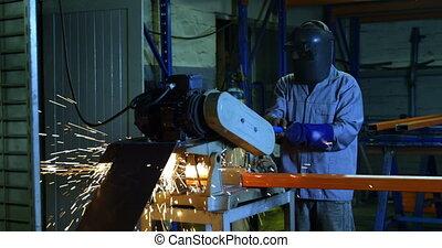 Metalsmith using cutter machine in workshop 4k - Attentive ...