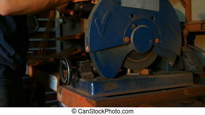 Metalsmith using machine in factory 4k - Mid section of ...