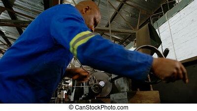 Metalsmith working in workshop 4k