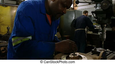 Metalsmith working in workshop 4k - Attentive metalsmith ...