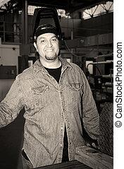 Metalworker In Factory Sepia - Friendly welder on the floor...