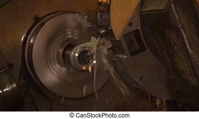 Metalworking sawing machine. Cutting metal modern processing technology.