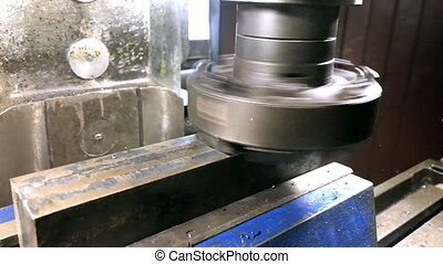metalworking.End speed milling cutter with hard-alloy plates mills metal clamped in machine torches on universal vertical milling machine,slow motion