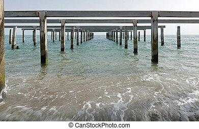 metaphisical pier in open water sea