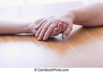Metaphor of support and care - Touching hands - metaphor of...
