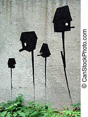 Metaphorical birdhouses on a concrete fence