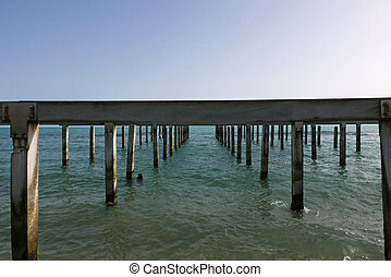 metaphysical pier in open water sea
