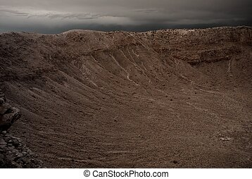 Meteor Crater - Meteor crater in Arizona with storm...