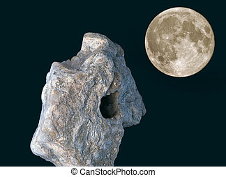Meteorite with the moon in night