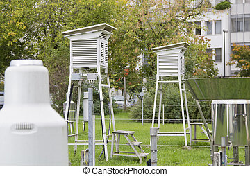 Various meteorological instruments and weather houses outdoors