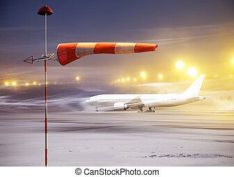 windsock - Meteorology windsock inflated by wind in airport...