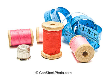 meter, thimble and spools of thread