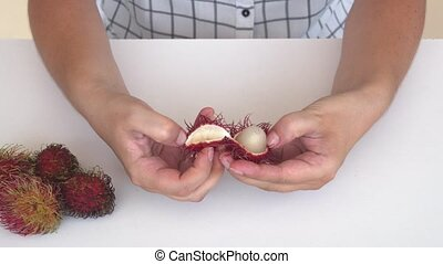 Method for Opening a Rambutan Fruit. FullHD 1080p video -...