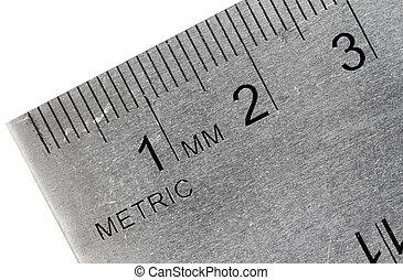 Macro shot of an industrial stainless steel ruler, metric side.